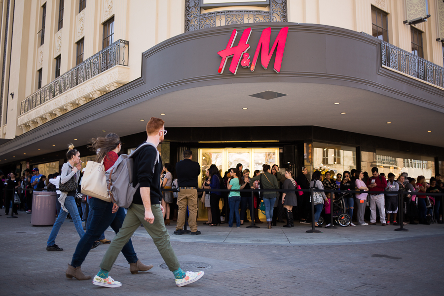 Shoppers line up outside the historic Joske's building for H&M's opening day. Photo by Scott Ball.