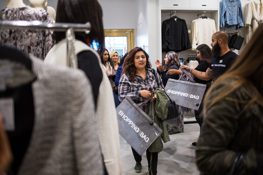 Shoppers crowd the new H&M located in the historic Joske's building part of the Shops at Rivercenter. Photo by Scott Ball.