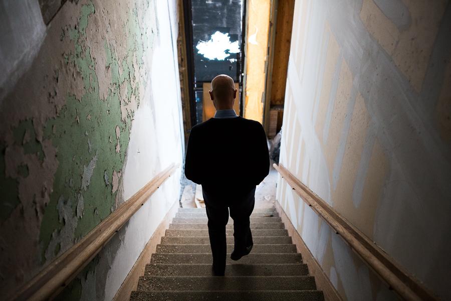 Weston Urban CEO Randy Smith walks down a stairway in the Savoy Building. Photo by Scott Ball.