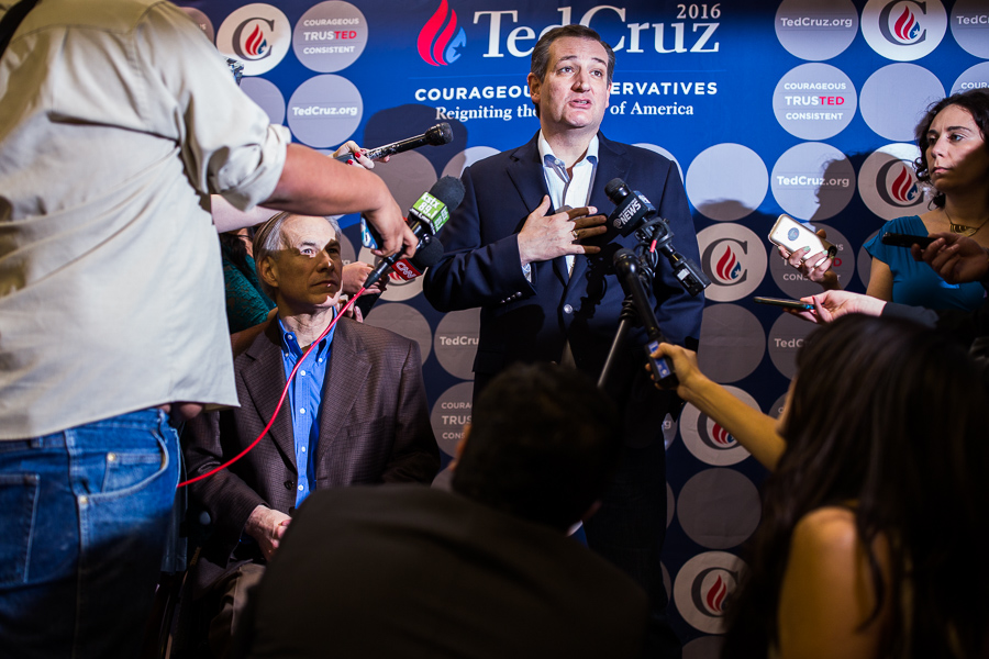 Ted Cruz responds to a question alongside Governor Greg Abbott during a press conference held immediately before his appearance. Photo by Scott Ball.