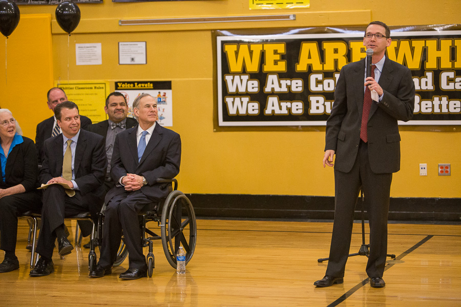 TEA Commissioner Mike Morath addresses students at Whittier Middle School in February 2016 as Gov. Greg Abbott and San Antonio ISD officials look on.