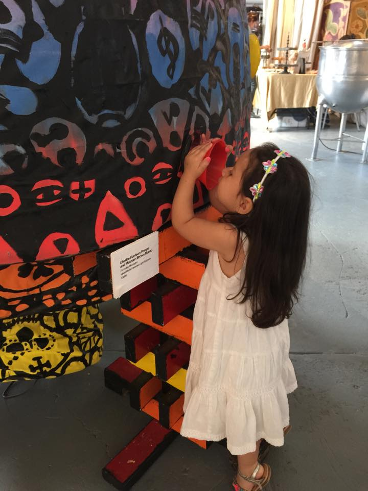 A young visitor uses senses besides vision to experience art at The Color of Blind. Courtesy Photo.