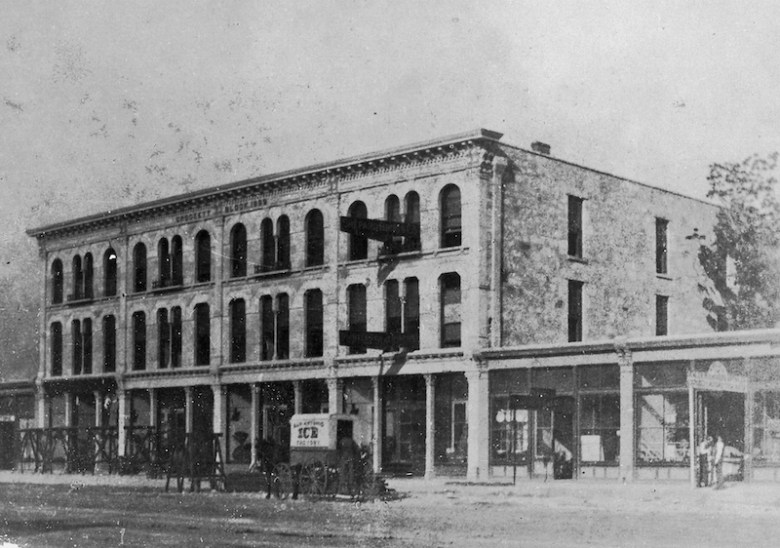 Undated view of the Crockett Block taken from a stereograph card. An ice wagon, perhaps making a delivery to the Alamo Café located inside the building, stands in front. Photo courtesy of the San Antonio Conservation Society Foundation