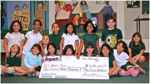 Participants in Girls, Inc. of San Antonio pose for photo with a $108,000 check as the 2015 Impact San Antonio Grant Recipient in Education. Photo courtesy of Impact San Antonio.