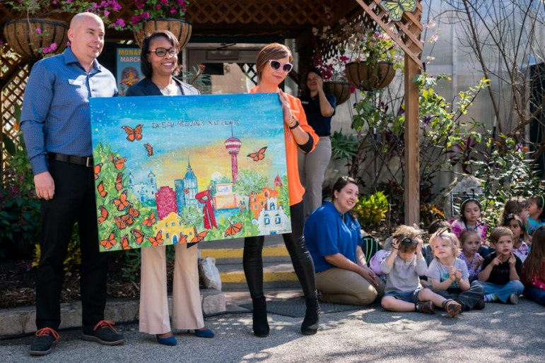 Mayor Ivy Taylor receives a Monarch themed art piece. Photo by Kathryn Boyd-Batstone