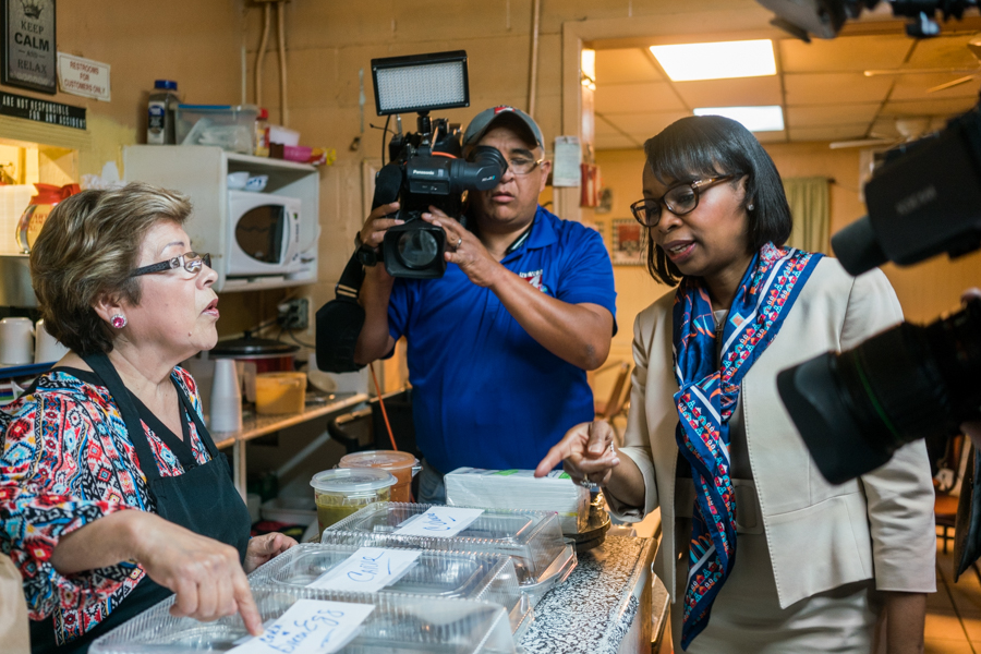 Mayor Ivy Taylor checks the 50 tacos prepared for taste test against Austin's Mayor Steve Adler. Photo by Kathryn Boyd-Batstone
