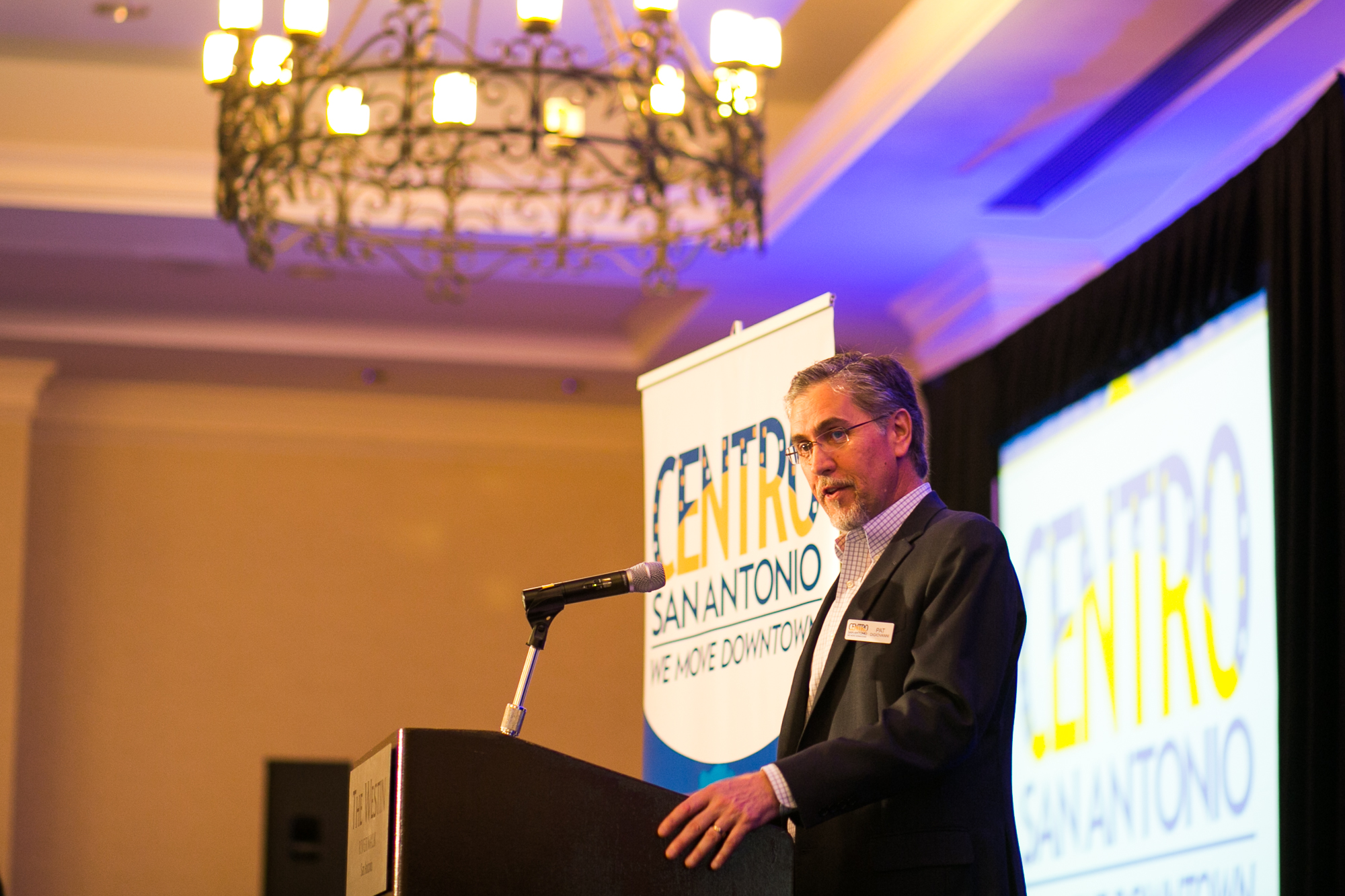 Centro CEO Pat DiGiovanni welcomes everyone to the luncheon For the Love of Downtown, featuring Peter Kageyama. Photo by Kathryn Boyd-Batstone