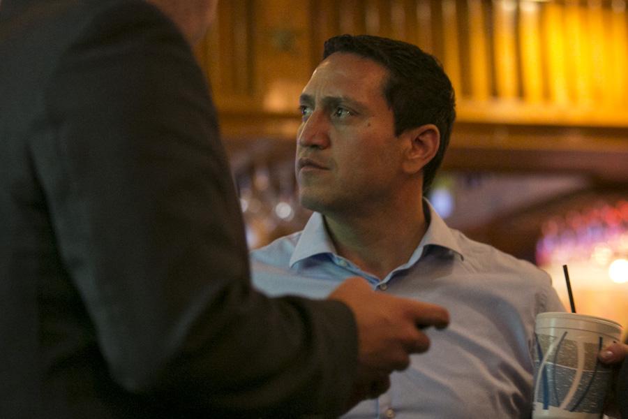 Trey Martinez Fischer watches early voting results trickle in. Photo by Kathryn Boyd-Batstone.