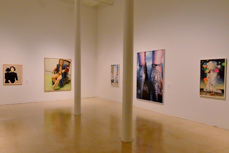 Portraits by Katz and Pearlstein (l) and the Minter flanked by O'Connor's collage works (r). Photo by Page Graham.