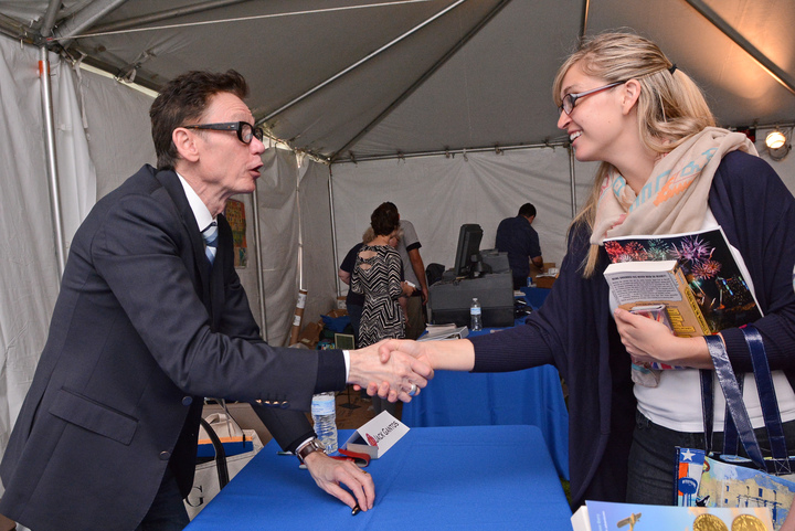 A happy fan shakes hands with Jack Gantos. Photo Courtesy of SABF.