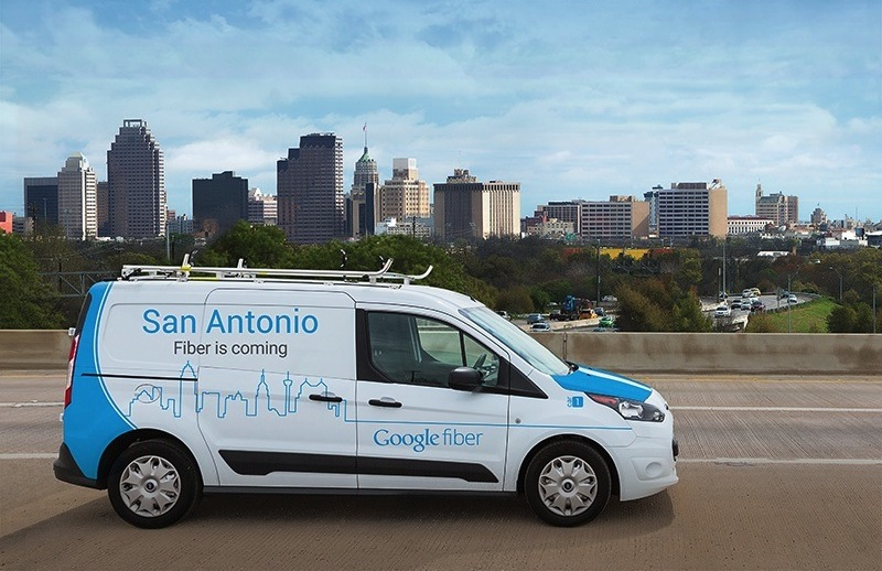 A Google Fiber van parked in front of the San Antonio skyline. Courtesy of the Google Fiber Facebook page.
