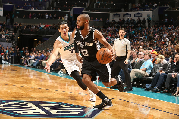 Patty Mills #8 of the San Antonio Spurs drives to the basket against Jeremy Lin #7 of the Charlotte Hornets on March 21, 2016 at Time Warner Cable Arena in Charlotte, North Carolina. Photo by Kent Smith/NBAE via Getty Images.