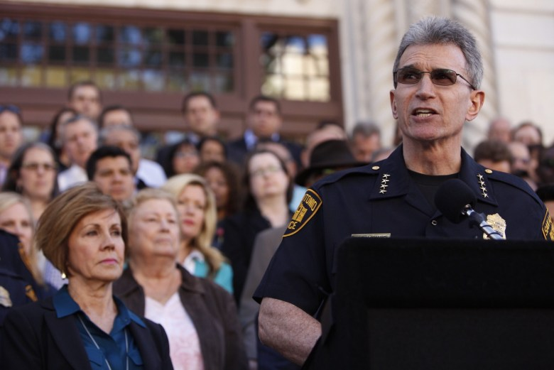 SAPD Chief William McManus speaks to reporters with more than 50 members of the City's executive team behind him. Photo by Scott Ball.