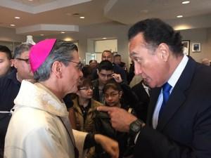 Former HUD Secretary and San Antonio Mayor Henry Cisneros converse with Archbishop Gustavo García-Siller. Photo by Robert Rivard.