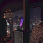 Plaza Club guests look through the top floor window of the Frost Bank Tower at Kinetic Skyline. Photo by Iris Dimmick.