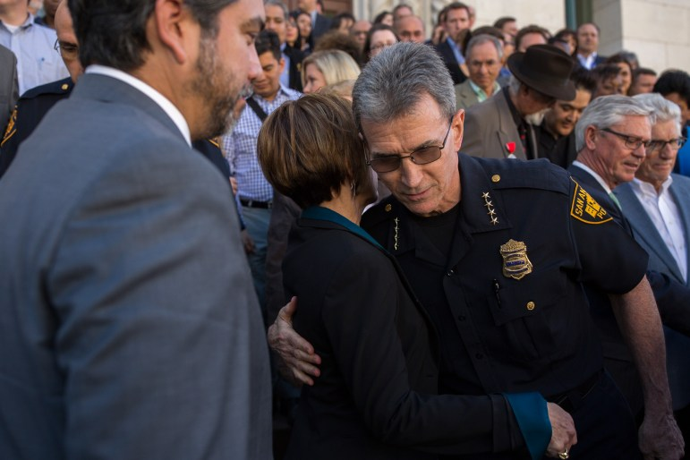 Chief William McManus and San Antonio City Manager Sheryl Sculley embrace following his speech during the press conference. Photo by Scott Ball.