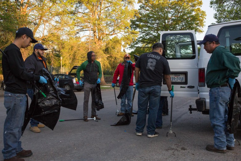 Community service volunteers receive bags, trash pickers, and instruction from a city employee. Photo by Scott Ball.