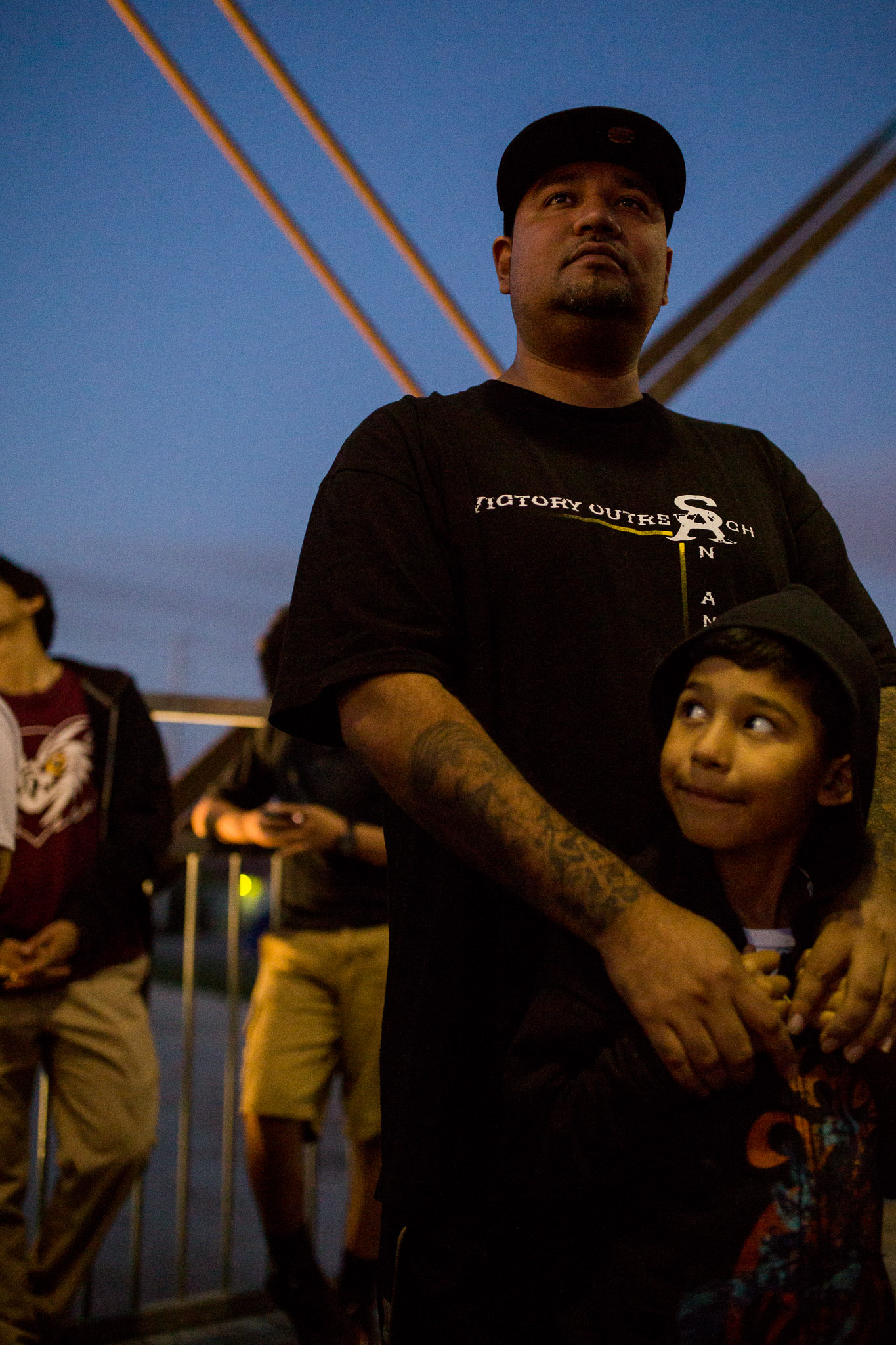Eastside residents Mark Espinosa and his son Mark Jr, 6, attend the press event. Photo by Scott Ball.