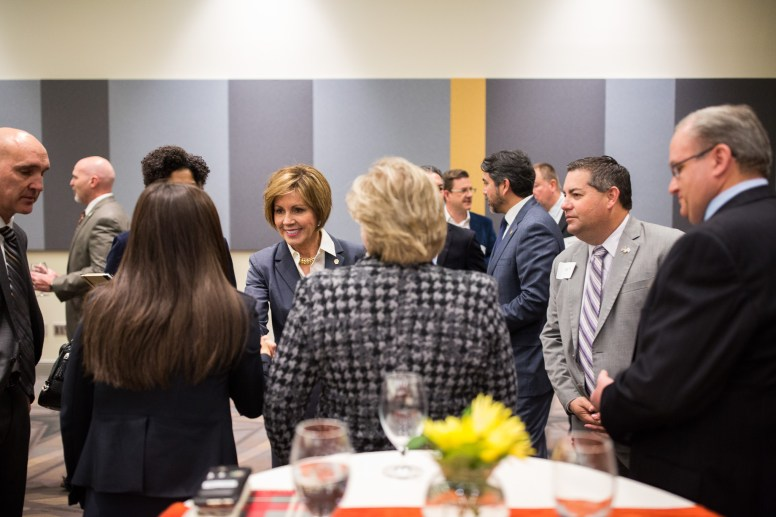 City Manager Sheryl Sculley greets guests as she arrives to the Henry B. Gonzales Convention Center. Photo by Scott Ball.