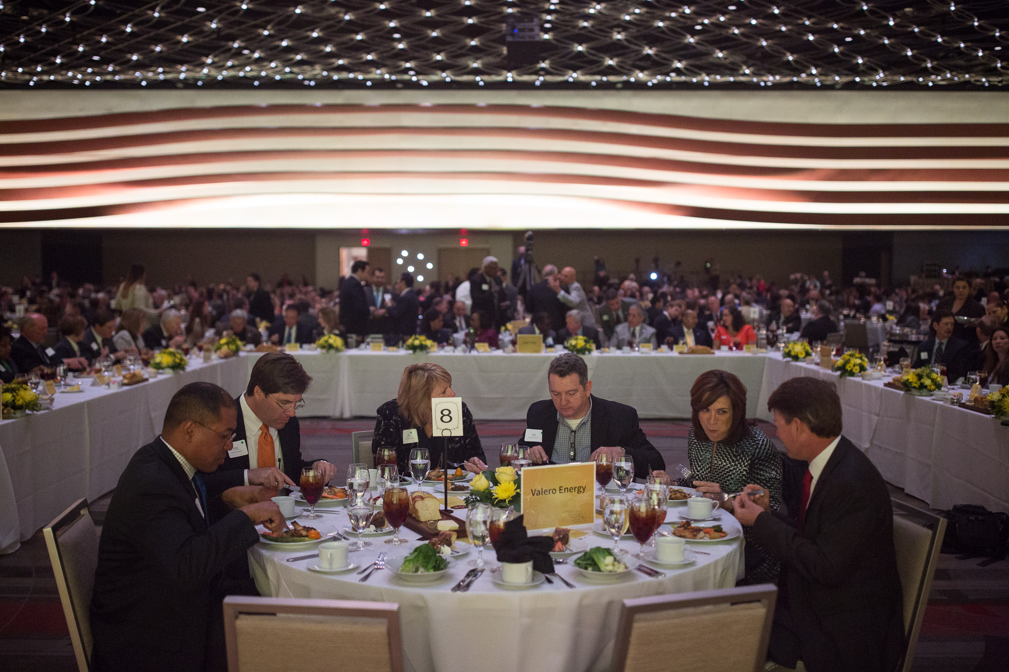 Valero Energy dines at a close proximity to the stage and in front of the head table. Photo by Scott Ball.