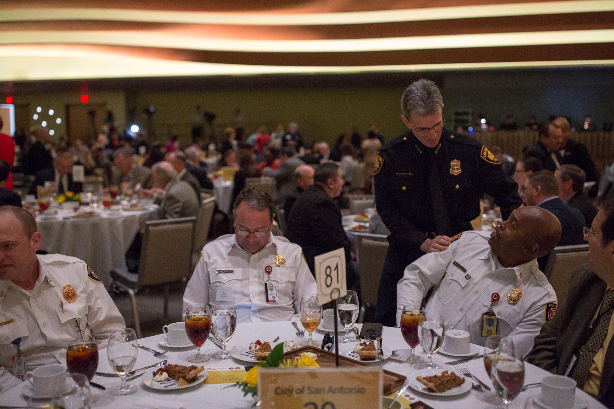 San Antonio Chief of Police William McManus greets San Antonio Fire Department Chief Charles Hood. Photo by Scott Ball.