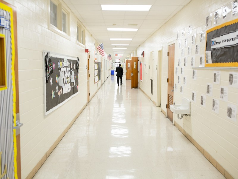 SAISD Superintendent Pedro Martinez walks down the halls of the Young Men's Leadership Academy. Photo by Scott Ball.