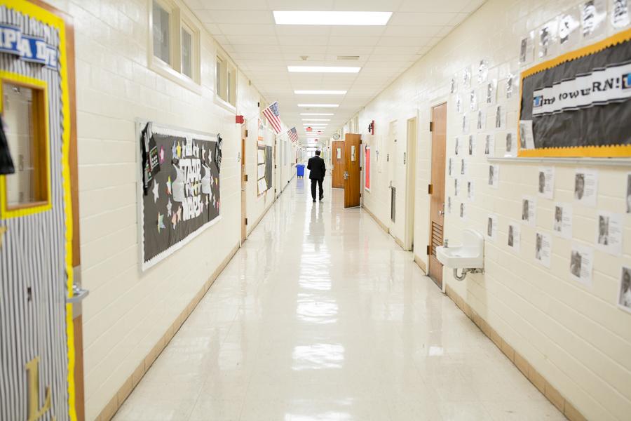 SAISD Superintendent Pedro Martinez walks down the halls of the Young Men's Leadership Academy. Photo by Scott Ball.