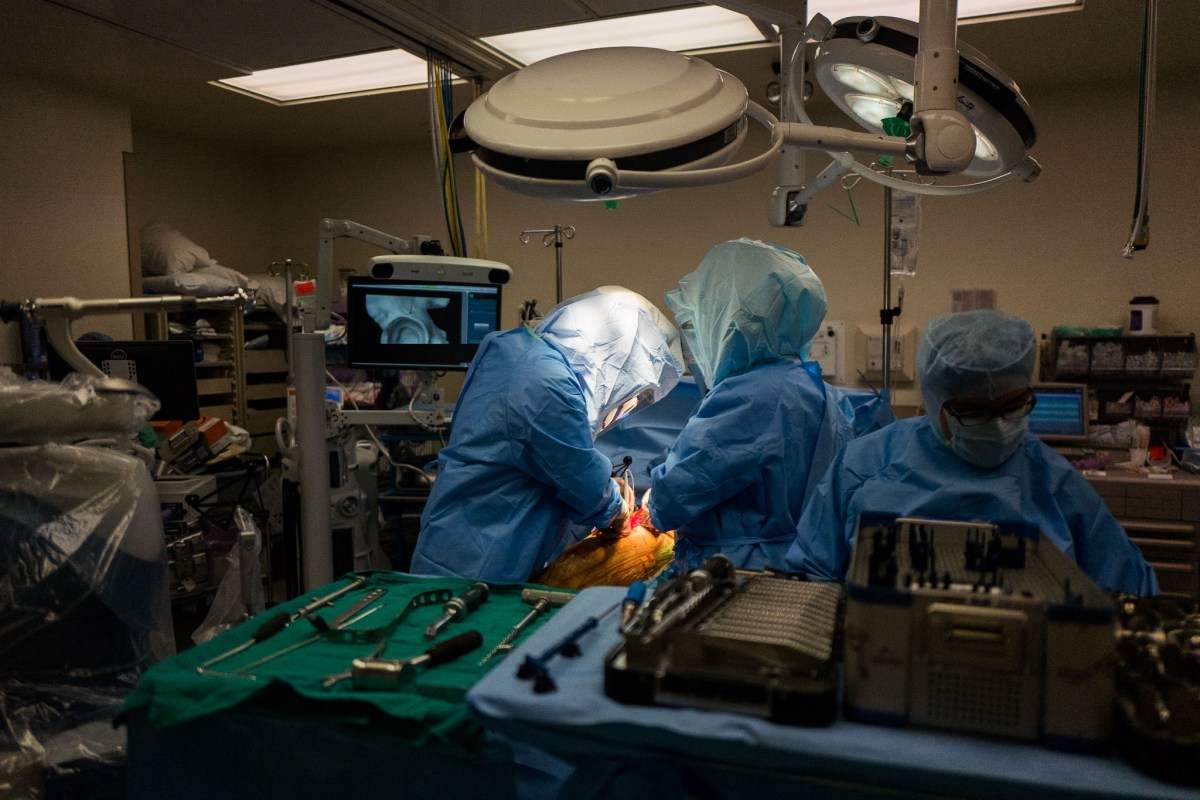 Orthopedic surgeon Dr. Matthew Morrey preps a hip for replacement using the Mako robotic tool. Photo by Scott Ball.