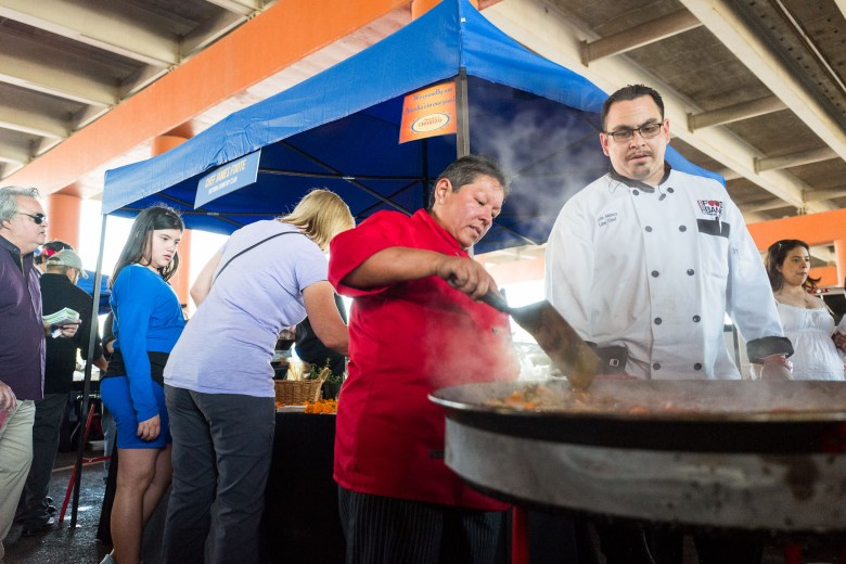 San Antonio Food Bank Chefs Martha Solis and John Munoz prepare a large skillet for more ingredients. Photo by Scott Ball.