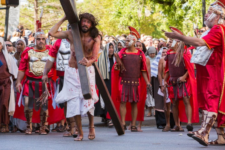 Jesus walks down Santa Rosa Street as he is followed by Romans and villagers. Photo by Scott Ball.