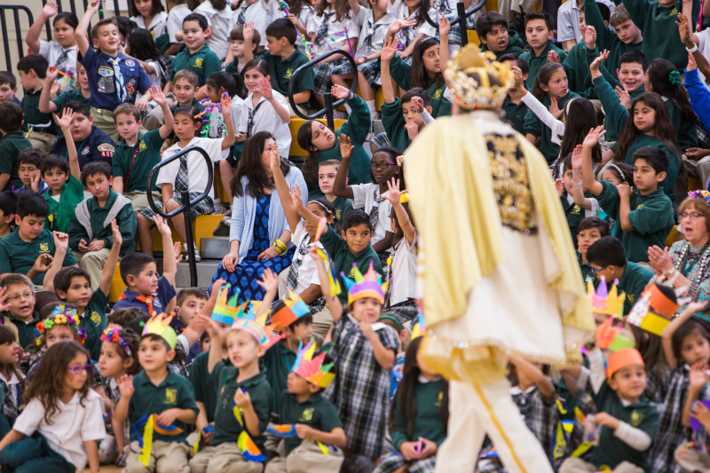 Rey Feo LXVIII Darren Casey asks students at St. Luke Catholic School to share their dreams with him. Photo by Scott Ball.