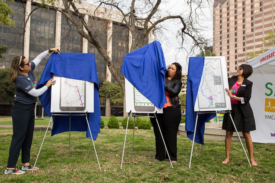 YMCA employees unveil the new sívlovía route at Travis Park. Photo by Scott Ball.