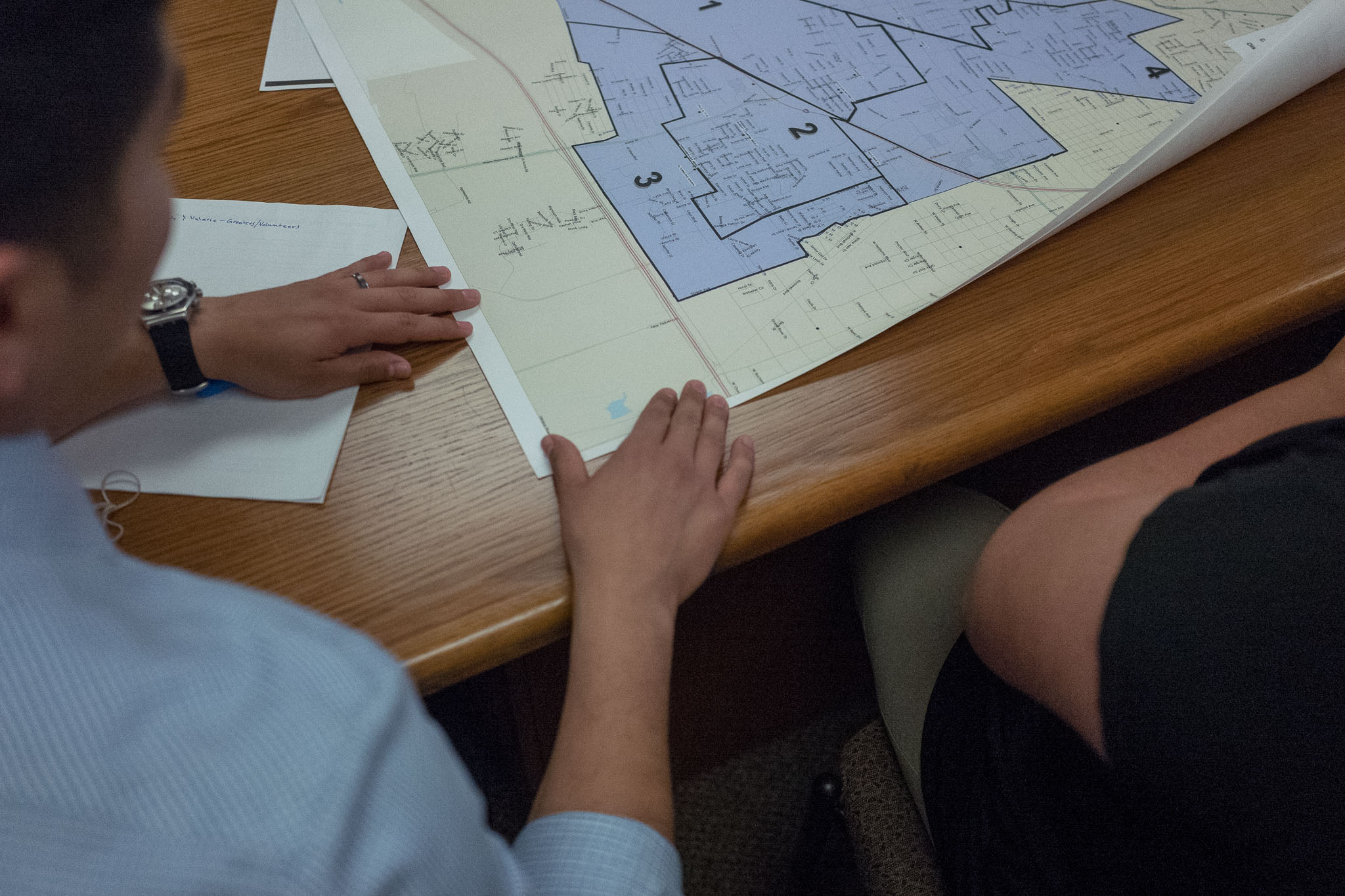 Councilman Rey Saldana (D4) lays a map of the South San School District on his conference table. Photo by Scott Ball.