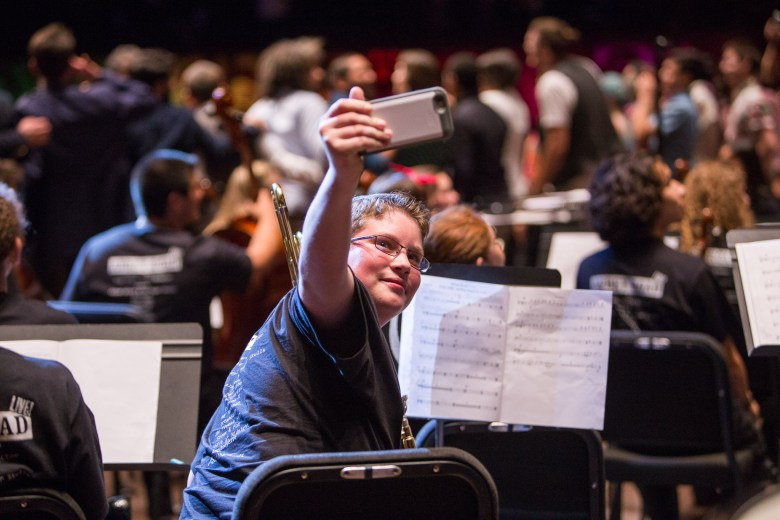 A YOSA trombonist takes a selfie following his performance. Photo by Scott Ball.