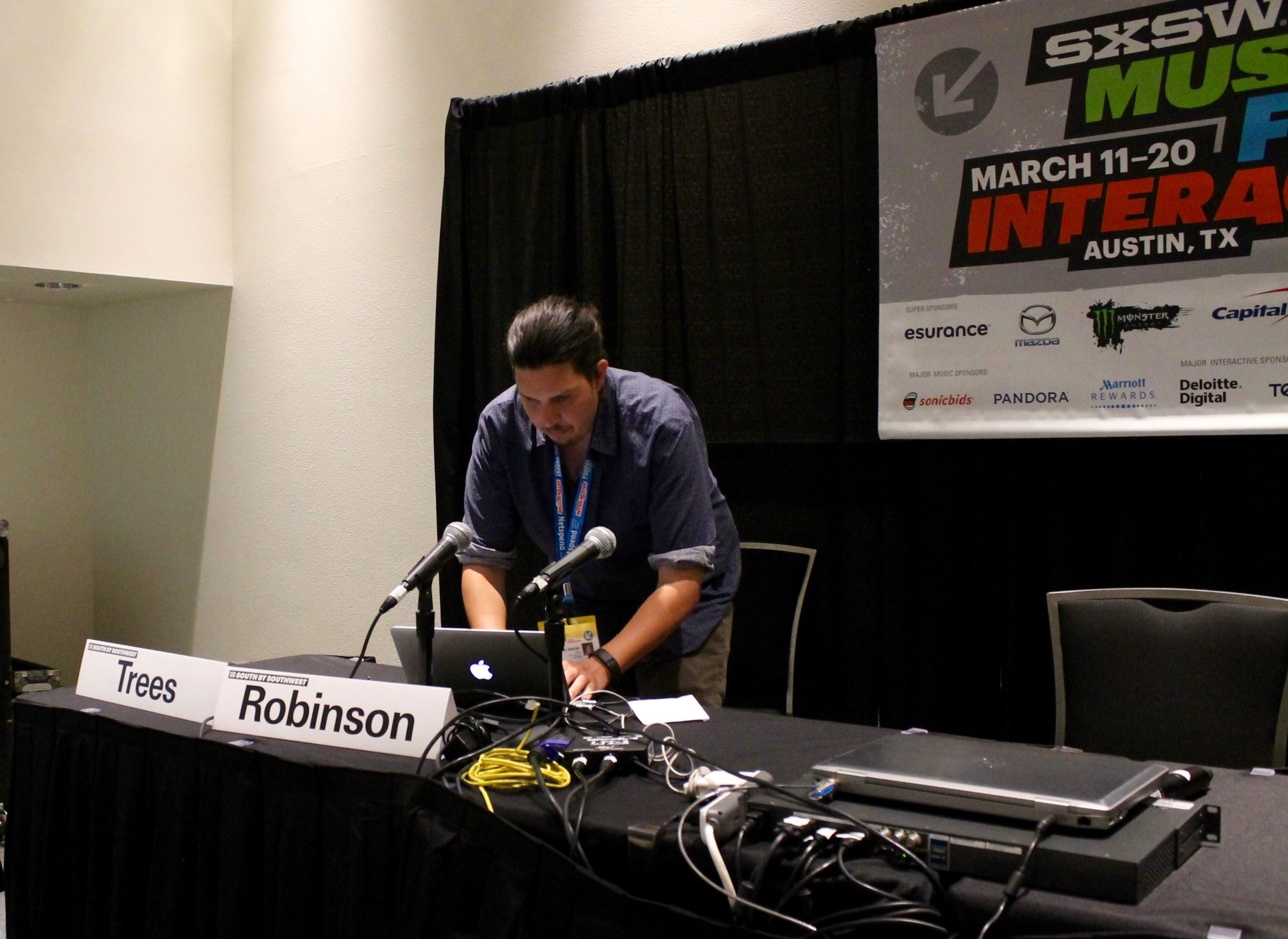 Ryan Beltran, founder of San Antonio company Elequa, preps a short video about open source water purification at the Austin Convention Center on Monday, March 14, 2016. Photo by Edmond Ortiz