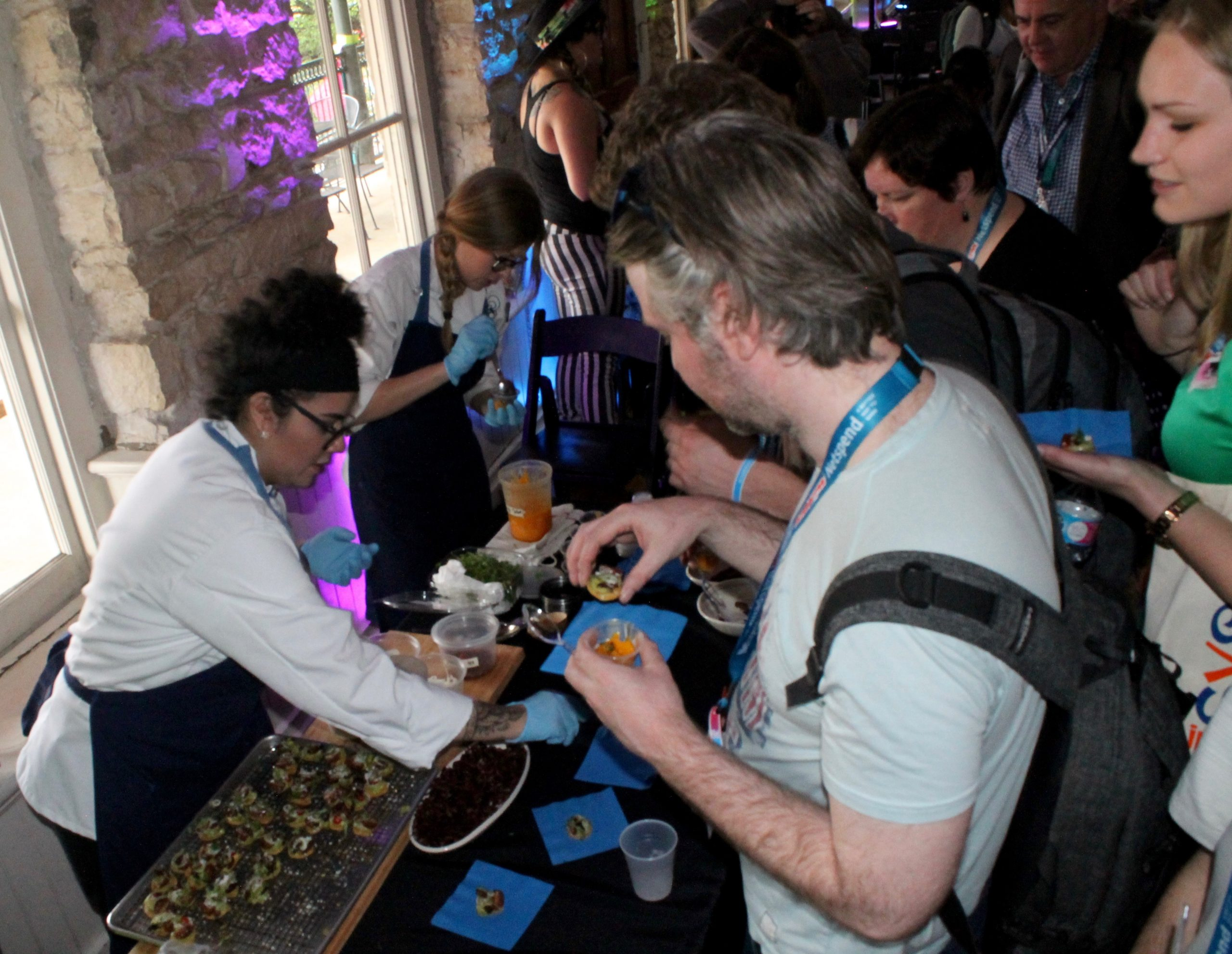 Employees of Mixtli Progressive Mexican Culinaria offer free grasshopper tostadas to panel discussion attendees at the Old School Bar and Grill, aka Casa San Antonio, during South by Southwest on Friday, March 11, 2016. Photo by Edmond Ortiz