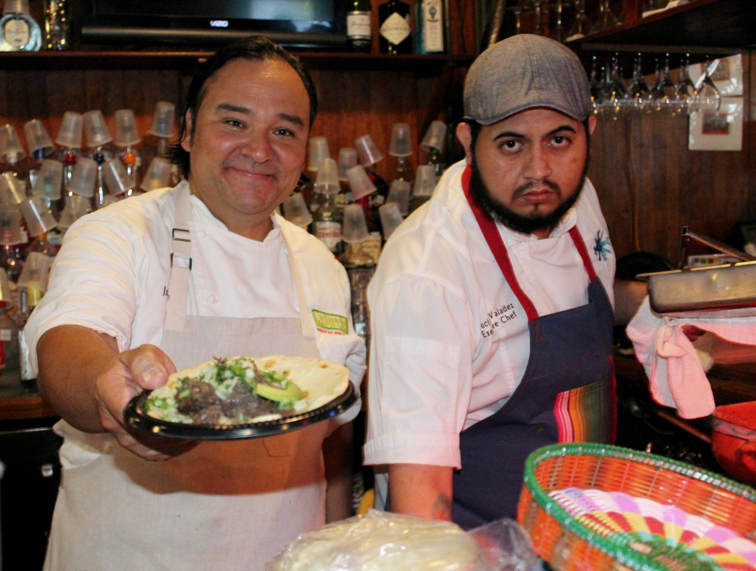 Chef Johnny Hernandez (left) and Executive Chef Luciano Valadez serve up fresh tacos during a competition at Old School Bar and Grill on Friday, March 11, 2016. The competition kicked off San Antonio's South by Southwest initiative. Photo by Edmond ortiz