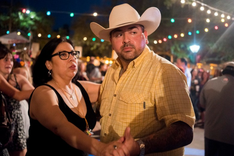 A couple dances at LaVillita's main stage off of South Alamo dance to country music. Photo by Kathryn Boyd-Batstone