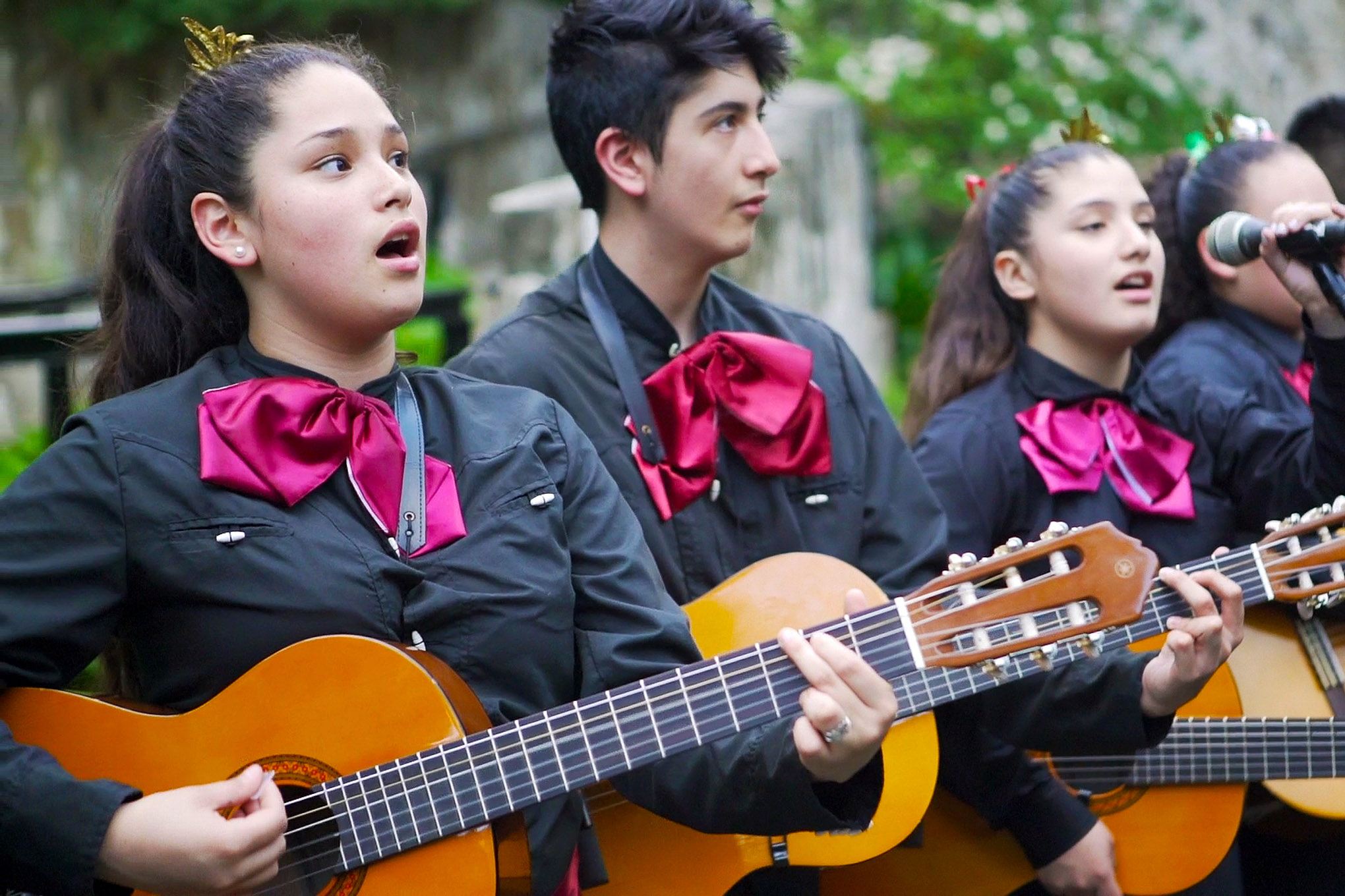 Wheatley Middle School students perform on a river barge along the Riverwalk as part of the Ford Mariachi Festival. Photo by Kathryn Boyd-Batstone