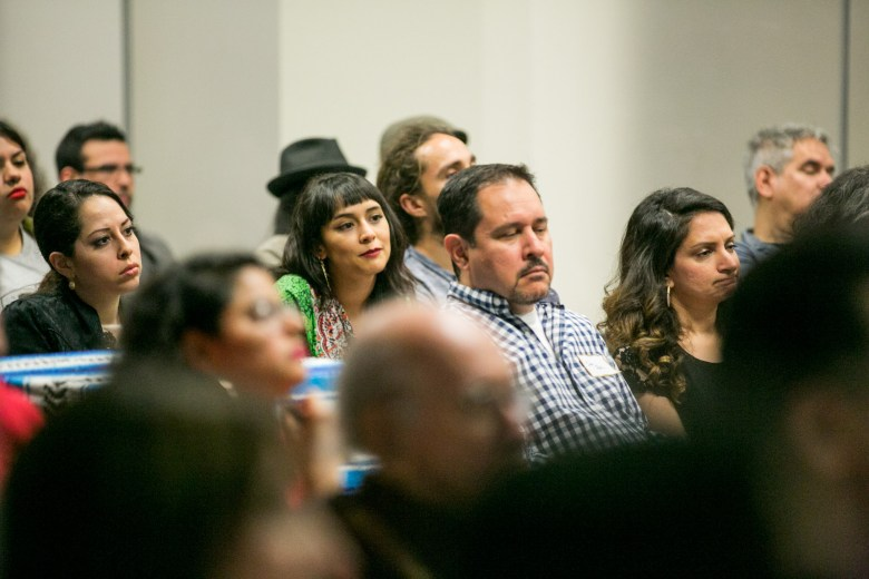 Audience members, including speaker Daniela Riojas listen to the stories of Latinos in the arts. Photo by Kathryn Boyd-Batstone