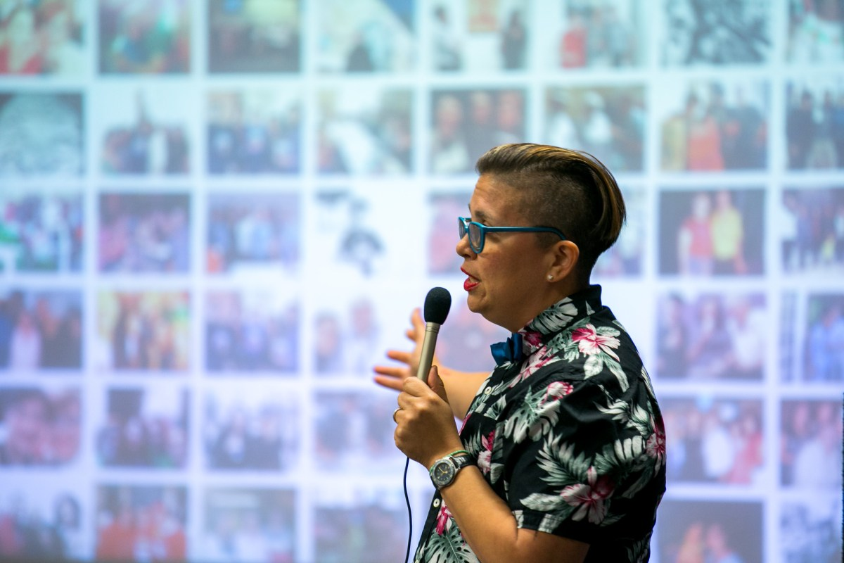 Artist Anel Flores speaks shows a slide of everyone who she is thankful to. Photo by Kathryn Boyd-Batstone