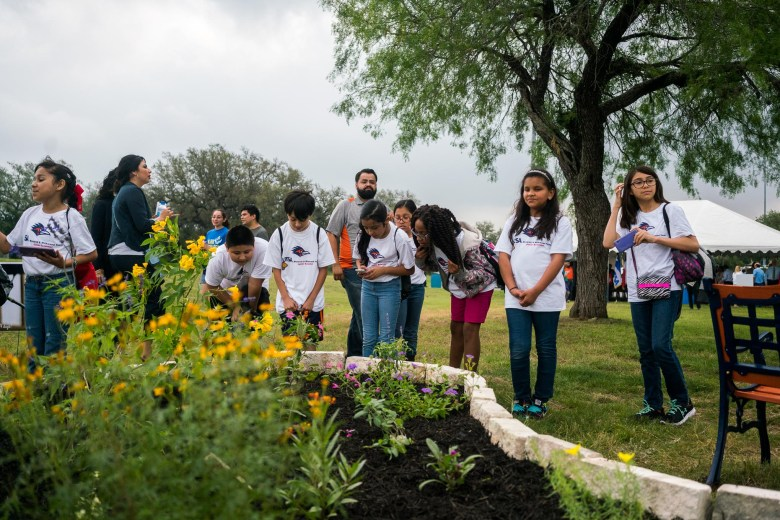 4th grade students from Glenoaks Elementary School look at the variety of vegetation planted for the Monarch butterflies. Photo by Kathryn Boyd-Batstone