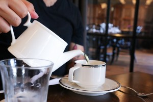 Chef Enrique Olvera serves himself some green tea at Supper. Photo by Bria Woods.