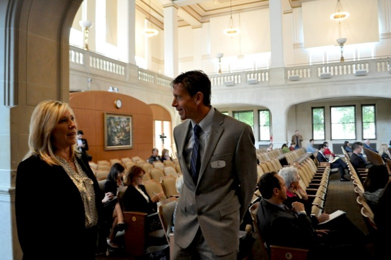 Mayor Ivy Taylor's Chief of Staff Jill DeYoung (left) talks with San Antonio FC Managing Director Tim Holt in City Council chambers. Photo by Iris Dimmick