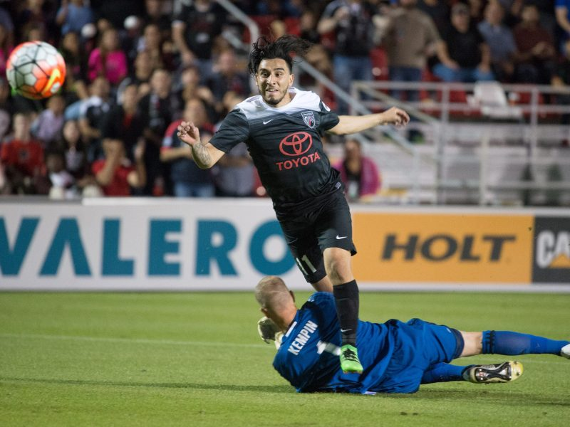 San Antonio FC midfielder Daniel Garcia, top, scores on Swope Park Rangers goalkeeper Jon Kempin during the first half of a USL soccer game, Saturday, April 9, 2016, in San Antonio. (Darren Abate/USL)