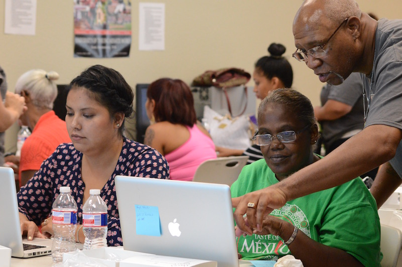 Hazel Green (right), a Springview Apartments resident, finishes her final computer test. Photo by Lea Thompson