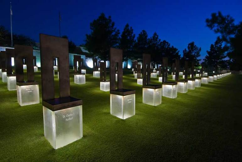 Many families have an empty chair at a holiday gathering as a reminder of a loved one who has passed on. There are 168 empty chairs at the Oklahoma Memorial, each bearing the name of someone who died on April 19, 1995. Image courtesy Oklahoma City National Memorial.