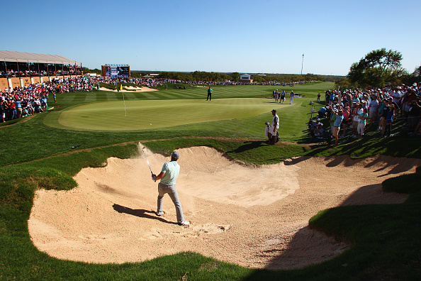 Jordan Spieth hits out of the bunker on the 18th hole during the final round of the Valero Texas Open at TPC San Antonio AT&T Oaks Course on March 29, 2015 in San Antonio, Texas. Photo by Marianna Massey/Getty Images.
