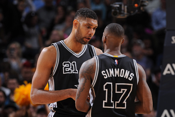 Tim Duncan #21 of the San Antonio Spurs talks with Jonathon Simmons #17 of the San Antonio Spurs during the game against the Denver Nuggets on April 8, 2016 at the Pepsi Center in Denver, Colorado. (Photo by Garrett Ellwood/NBAE via Getty Images)