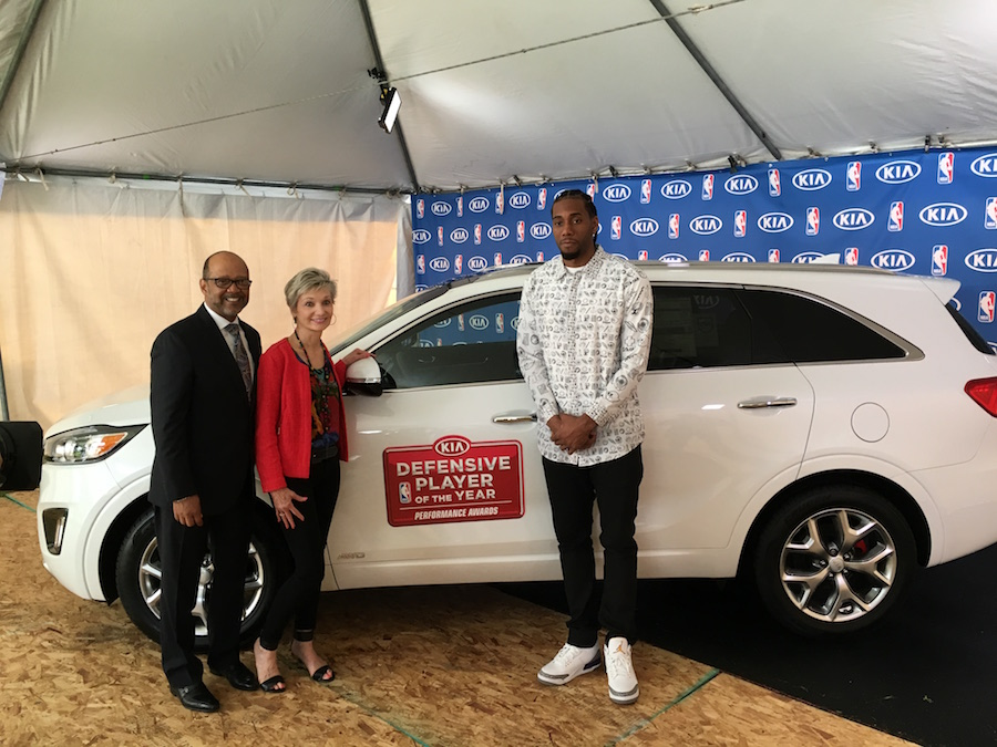Spurs star Kawhi Leonard chose the Children's Bereavement Center of South Texas to be the recipient of the Kia Sorento CUV he was awarded as the NBA's Kia Defensive Player of the Year Award. He presented the keys to Marfian Sokol, Executive Director of the Bereavement Center. Percy Vaughn represented Kia Motors America at the ceremony.